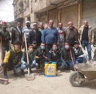 الشبيبة الفتحاوية وكـوادر حركة «فتح» تقوم بأعمال التعقيم للشوارع الرئيسية والفرعية في المخيمات الفلسطينية في سوريا