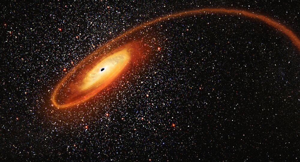 ثقب أسود يلتهم نجم