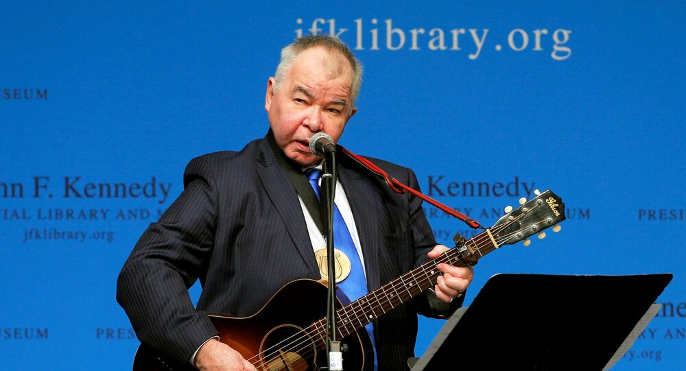 Musician John Prine performs after accepting his PEN New England Song Lyrics of Literary Excellence Award during a ceremony at the John F. Kennedy Library in Boston, Massachusetts, U.S. September 19, 2016.
