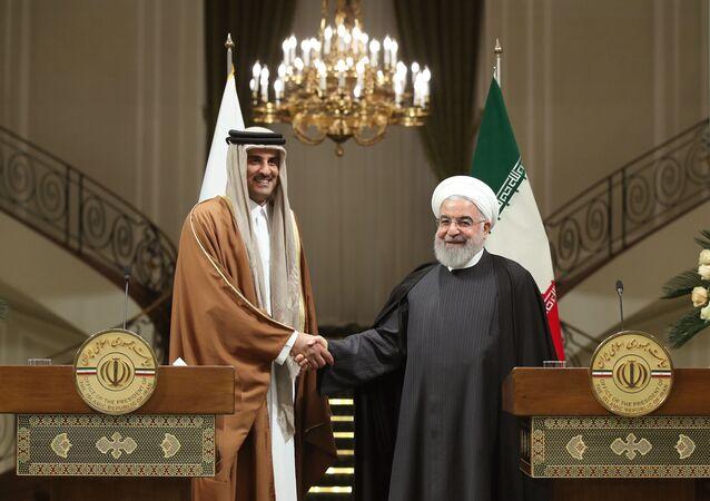 أمير القطر تميم بن حمد آل ثاني مع الرئيس الإيراني حسن روحاني