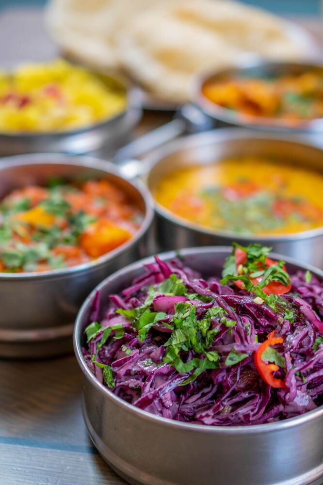 الصورة بعنوان مأدبة الكاري، للمصورة البريطانية فيليبا أسكيو، الفائزة في فئة طعام الطلاب من مسابقة Pink Lady® لأفضل مصور الطعام لعام 2020