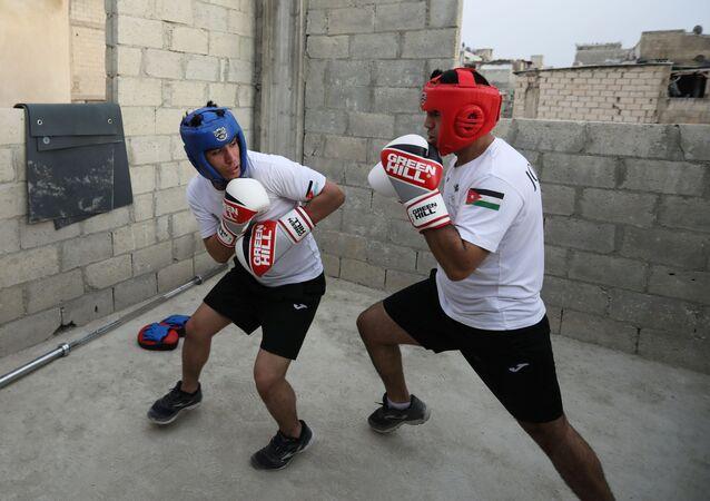 الملاكمان الأردنيان حسين وزيد عشيش