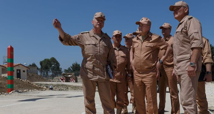 وزير الدفاع الروسي سيرغي شويغو يتفقد تنظيم الخدمة العسكرية الروسية في قاعدة حميميم الجوية في سوريا18 يونيو 2016