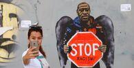 جدارية  فنان الشوارع الإيطالي سالفاتوري بينينتندي، للمواطن الأمريكي من أصول أفريقية، جورج فلويد، في برشلونة، إسبانيا 31 مايو 2020