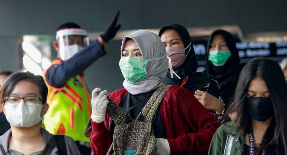 ارتداء الكمامات في إندونيسيا