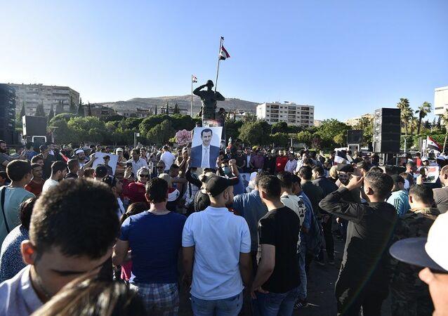 تجمع جماهيري بالعاصمة السورية تنديدا بـقانون قيصر